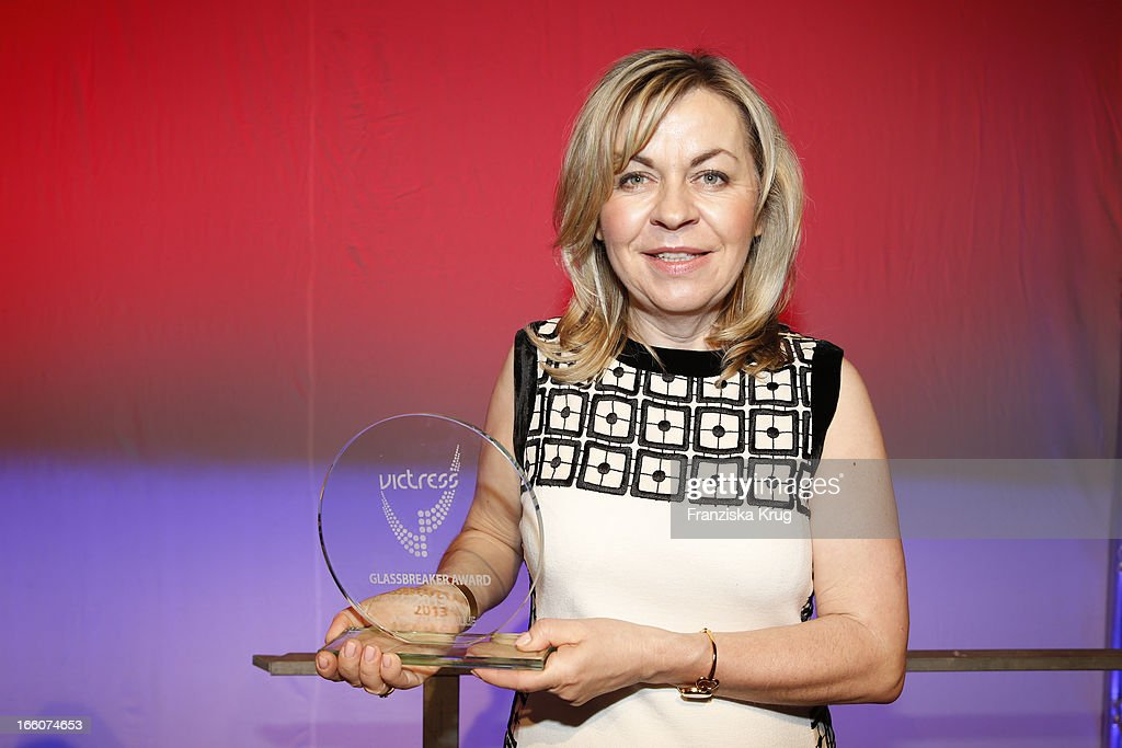 Andrea Galle receives an award at the Victress Day Gala 2013 at the MOA Hotel on April 8, 2013 in Berlin, Germany.
