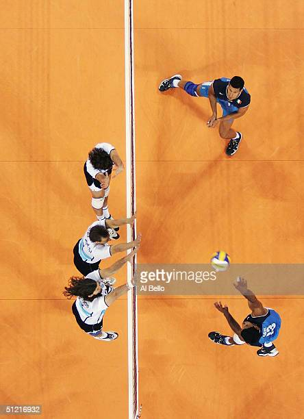 Andrea Giani of Italy spikes the ball against Argentina in the men's indoor Volleyball quarterfinal match on August 25 2004 during the Athens 2004...