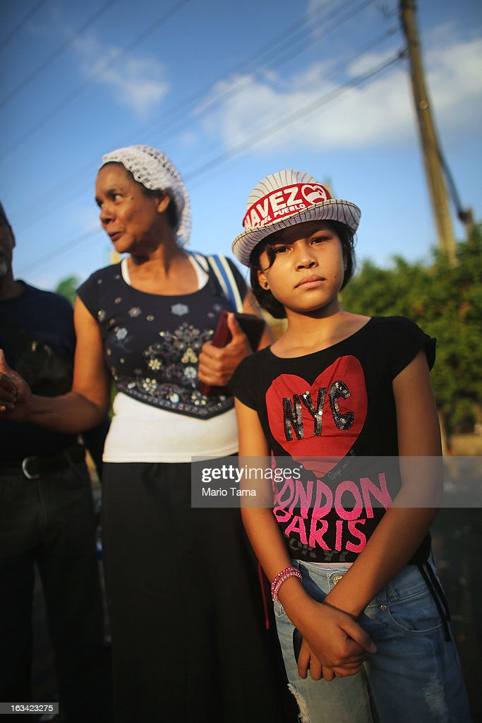 Andrea Gonzalez (R) poses wearing a Chavez hat with America Saiz as they wait in line to view the body of deceased Venezuelan President Hugo Chavez on March 9, 2013 in Caracas, Venezuela. Venezuelans continue to wait in line for hours to pay their last respects to Chavez on the day after his funeral. Venezuela's elections commission has set April 14 as the date for voting to replace the late Chavez.