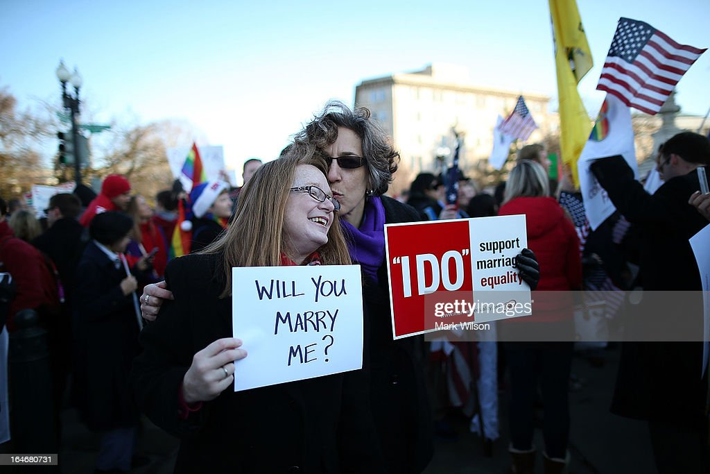 Andrea Grill (R) and Lee Ann Hopkins (L), from Alexandria VA. embrace after becoming engaged during a rally outside of the U.S Supreme Court, on March 26, 2013 in Washington, DC. Today the high court is scheduled to hear arguments in California's proposition 8, the controversial ballot initiative that defines marriage as between a man and a woman.