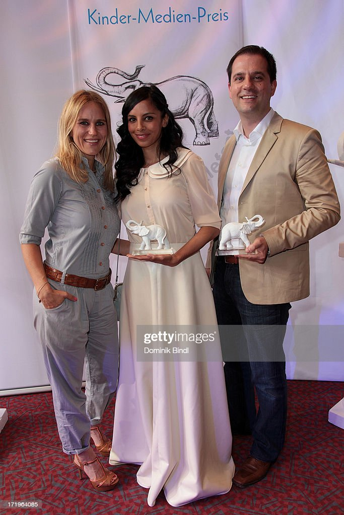 Andrea Guenther, Collien Fernandes and Hannes Heyelmann attend the award event 'Kinder-Medien-Preis 2013 at Gasteig on June 30, 2013 in Munich, Germany.Cartoon Network's local production 'Cartoon Network Spurensuche - Schnitzeljagd war gestern' with host <a gi-track='captionPersonalityLinkClicked' href=/galleries/search?phrase=Collien+Ulmen-Fernandes&family=editorial&specificpeople=235967 ng-click='$event.stopPropagation()'>Collien Ulmen-Fernandes</a> was awarded at the event.