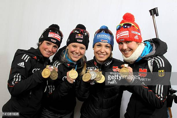 Andrea Henkel Miriam Goessner Magdalena Neuner and Tina Bachmann of Germany show their medals of the Women's 4 x 6km Relay with her team mate Andrea...