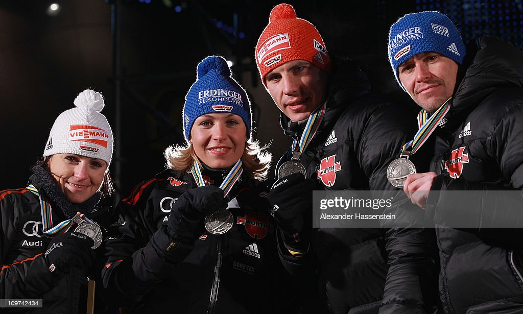 Andrea Henkel (L) of Germany and his team mates <a gi-track='captionPersonalityLinkClicked' href=/galleries/search?phrase=Magdalena+Neuner&family=editorial&specificpeople=2095093 ng-click='$event.stopPropagation()'>Magdalena Neuner</a> (2nd R), Arnd Pfeiffer (2nd R) and <a gi-track='captionPersonalityLinkClicked' href=/galleries/search?phrase=Michael+Greis&family=editorial&specificpeople=702831 ng-click='$event.stopPropagation()'>Michael Greis</a> (R) pose with their silver medal of the mixed relay after the medal ceremony of the IBU Biathlon World Championships on March 3, 2011 in Khanty-Mansiysk, Russia.