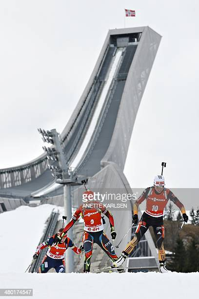 Andrea Henkel of Germany and Veronika Vitkova of the Czech Republic compete in the women's 125 km mass start event of the biathlon World Cup at the...