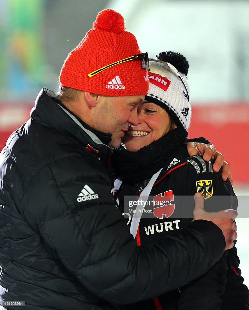 Andrea Henkel (R) of Germany celebrate with assistent coach Gerald Hoenig after winning the silver medal in the Women's 15km Individual during the IBU Biathlon World Championships at Vysocina Arena on February 13, 2013 in Nove Mesto na Morave, Czech Republic.