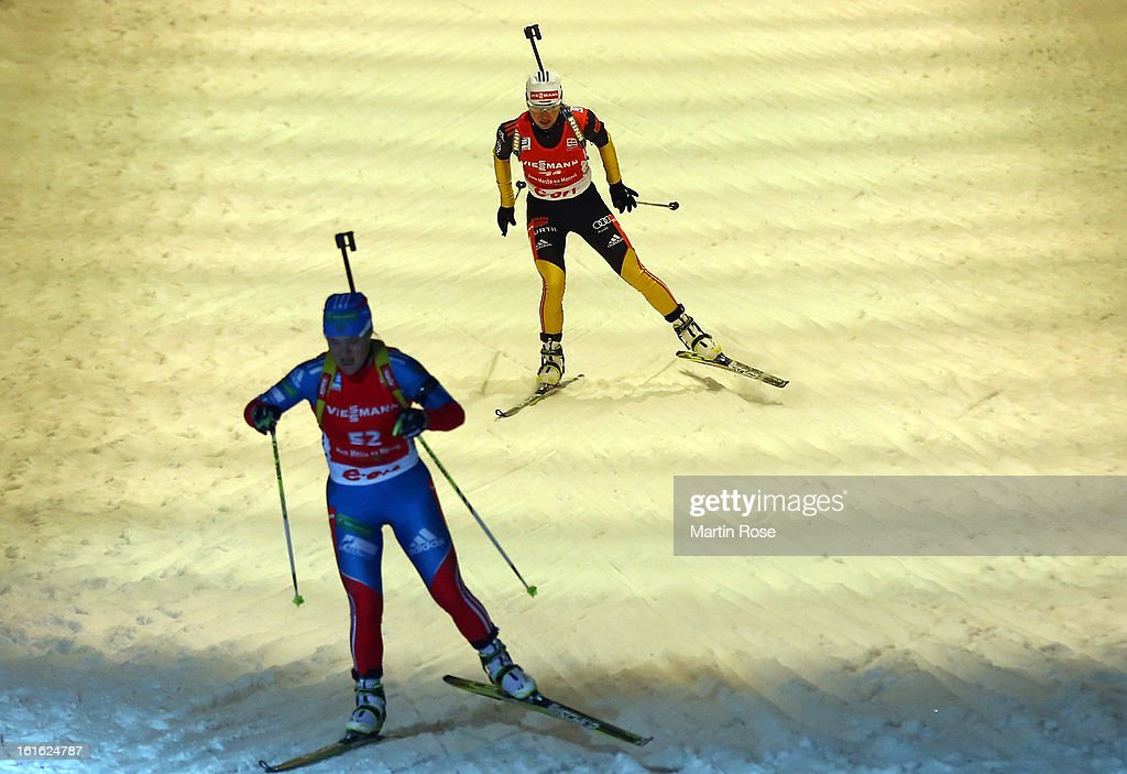 Andrea Henkel (back) of Germany competes in the Women's 15km Individual during the IBU Biathlon World Championships at Vysocina Arena on February 13, 2013 in Nove Mesto na Morave, Czech Republic.