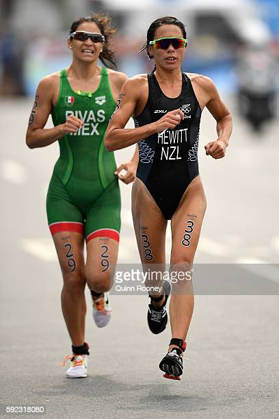 Andrea Hewitt of New Zealand and Claudia Rivas of Mexico run during the Women's Triathlon on Day 15 of the Rio 2016 Olympic Games at Fort Copacabana...