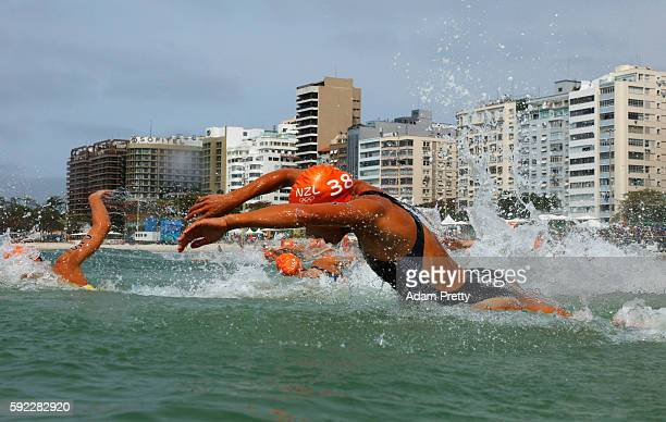 Andrea Hewitt of New Zealand dives into the water at the race start during the Women's Triathlon on Day 15 of the Rio 2016 Olympic Games at Fort...