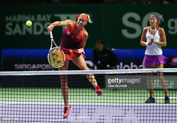 Andrea Hlavackova and Lucie Hradecka of Czech Republic in action against Abigail Spears and Raquel KopsJones of the USA during the BNP Paribas WTA...