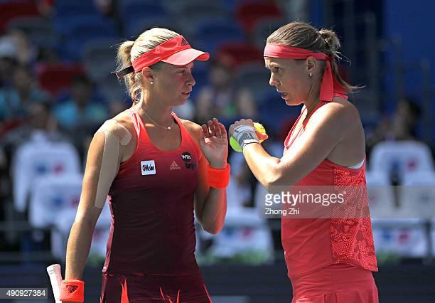Andrea Hlavackova of Czech Republic and Lucie Hradecka of Cezch Republic react during the doubles semifinal match against IrinaCamelia Begu of...