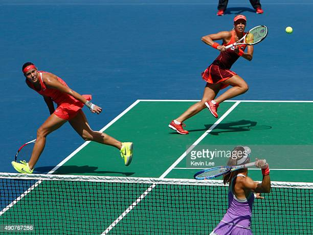 Andrea Hlavackova of Czech Republic and Lucie Hradecka of Czech Republic in action against Gabriela Dabrowski of Canada and Alicja Rosolska of Poland...