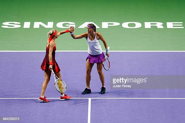 Andrea Hlavackova of Czech Republic and Lucie Hradecka of Czech Republic in action during their doubles round robin match against Timea Babos of...