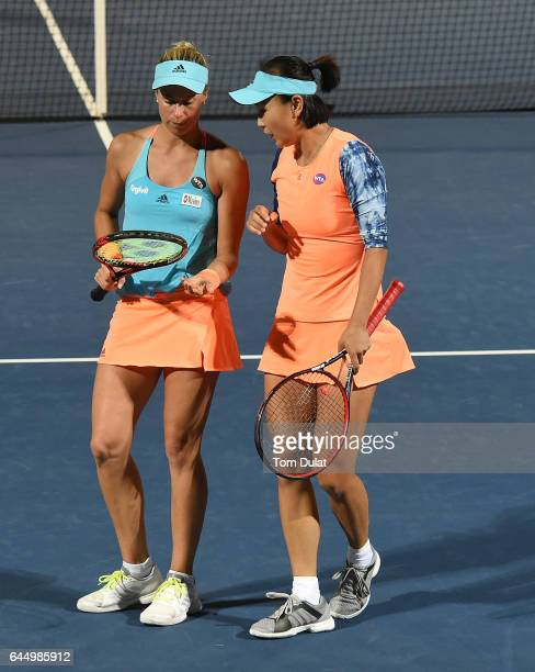 Andrea Hlavackova of Czech Republic and Shuai Peng of China discuss tactics during their doubles semi final match against HaoChing Chan of Taiwan and...