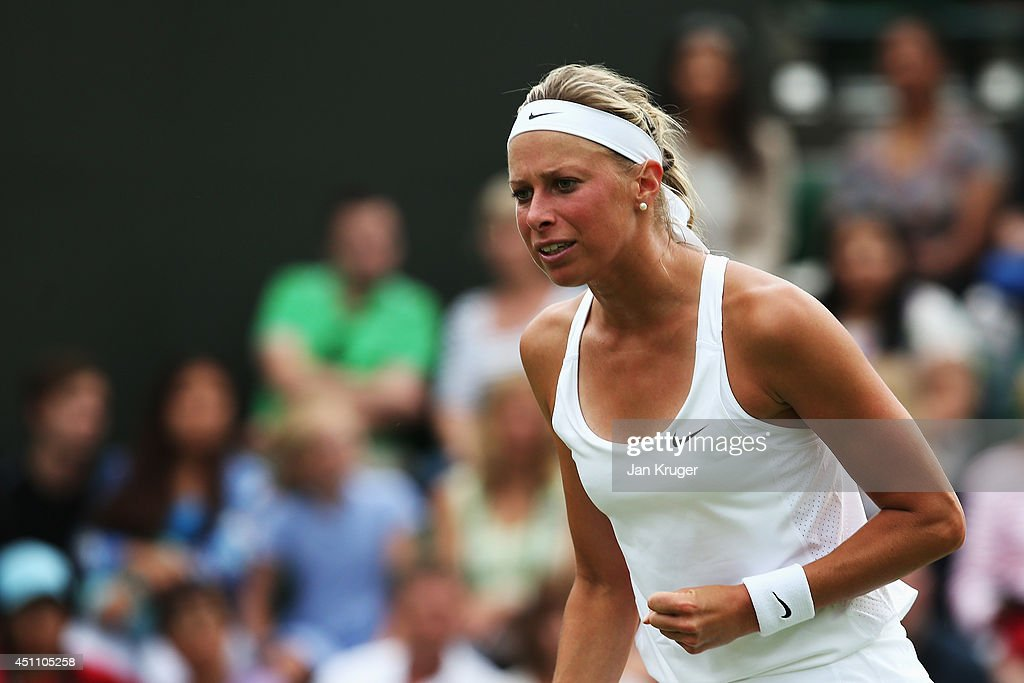 <a gi-track='captionPersonalityLinkClicked' href=/galleries/search?phrase=Andrea+Hlavackova&family=editorial&specificpeople=3378910 ng-click='$event.stopPropagation()'>Andrea Hlavackova</a> of Czech Republic reacts during her Ladies' Singles first round match against Petra Kvitova of Czech Republic on day one of the Wimbledon Lawn Tennis Championships at the All England Lawn Tennis and Croquet Club at Wimbledon on June 23, 2014 in London, England.