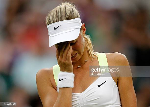 Andrea Hlavackova of Czech Republic shows her dejection during her Ladies' singles second round match against Kim Clijsters of Belgium on day three...