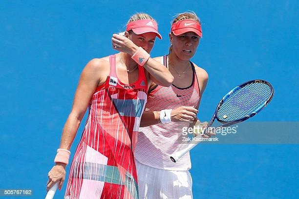 Andrea Hlavackova of the Czech Republic and Lucie Hradecka of the Czech Republic talk tactics in their first round doubles match against Shuko Aoyama...