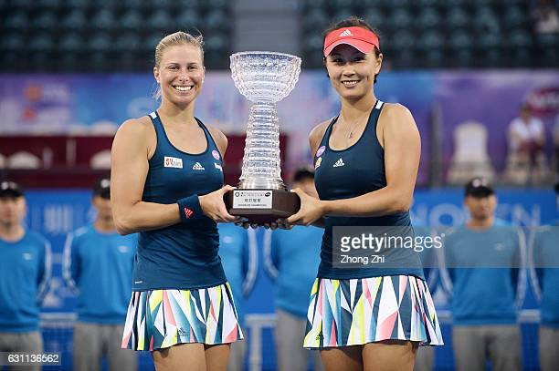 Andrea Hlavackova of the Czech Republic and Peng Shuai of China pose for photo after winning the doubles final match against Raluca Olaru of Romania...