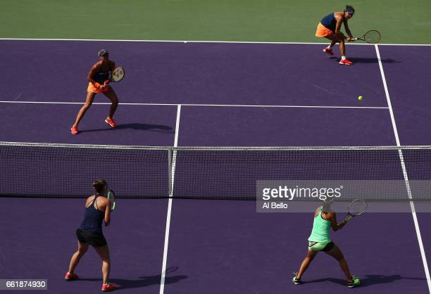 Andrea Hlavackova of the Czech Republic and Shuai Peng of China in action against Yifan Xu of China and Gabriela Dabrowski of Canada during Day 12 of...
