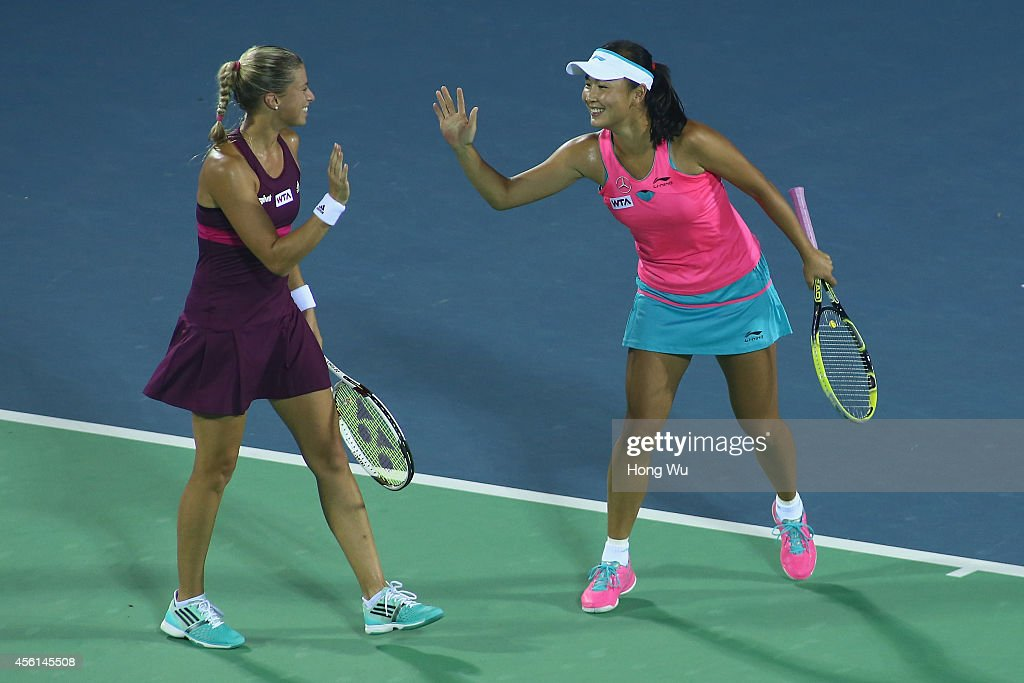 <a gi-track='captionPersonalityLinkClicked' href=/galleries/search?phrase=Andrea+Hlavackova&family=editorial&specificpeople=3378910 ng-click='$event.stopPropagation()'>Andrea Hlavackova</a> of the Czech Republic (L) and <a gi-track='captionPersonalityLinkClicked' href=/galleries/search?phrase=Shuai+Peng&family=editorial&specificpeople=274710 ng-click='$event.stopPropagation()'>Shuai Peng</a> of China react during the doubles match against Cara Black of Zimbabwe and Caroline Garcia of France on day six of 2014 Dongfeng Motor Wuhan Open at Optics Valley International Tennis Center on September 26, 2014 in Wuhan, China.