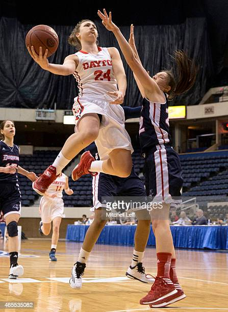 Andrea Hoover of the Dayton Flyers attempts a layup over Olivia Bresnahan of the Duquesne Dukes in the semifinals of the Women's Atlantic 10...