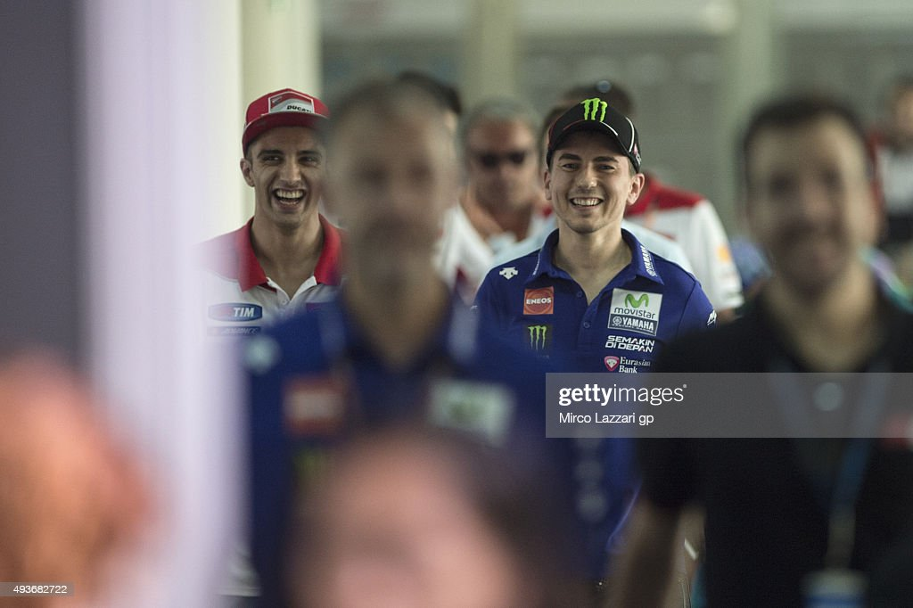 Andrea Iannone of Italy and Ducati Team (L) and Jorge Lorenzo of Spain and Movistar Yamaha MotoGP arrive and smile at the press conference ahead of the MotoGP of Malaysia at Sepang Circuit on October 22, 2015 in Kuala Lumpur, Malaysia.