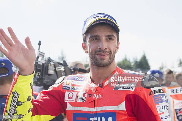 Andrea Iannone of Italy and Ducati Team celebrates the third place at the end of the qualifying practice during the MotoGp of Czech Republic...