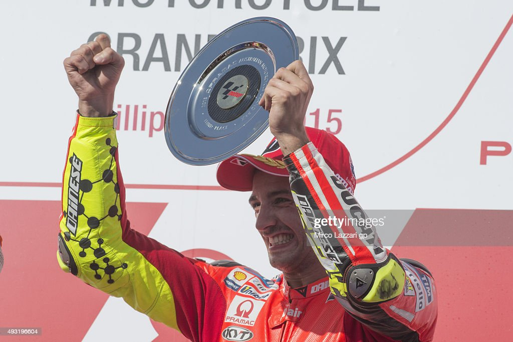 <a gi-track='captionPersonalityLinkClicked' href=/galleries/search?phrase=Andrea+Iannone&family=editorial&specificpeople=5314381 ng-click='$event.stopPropagation()'>Andrea Iannone</a> of Italy and Ducati Team celebrates the third place on the podium at the end of the MotoGP race during the MotoGP of Australia - Race during the 2015 MotoGP of Australia at Phillip Island Grand Prix Circuit on October 18, 2015 in Phillip Island, Australia.