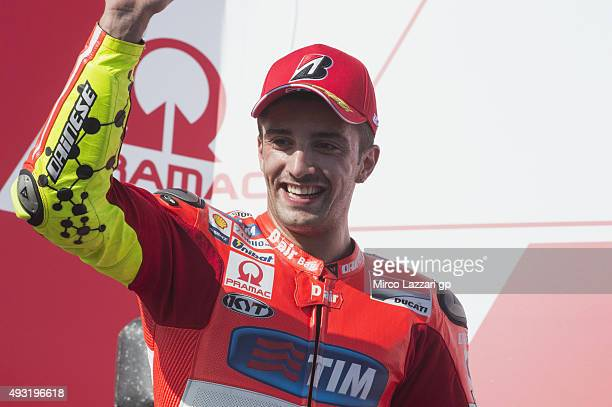 Andrea Iannone of Italy and Ducati Team celebrates the third place on the podium at the end of the MotoGP race during the MotoGP of Australia Race...
