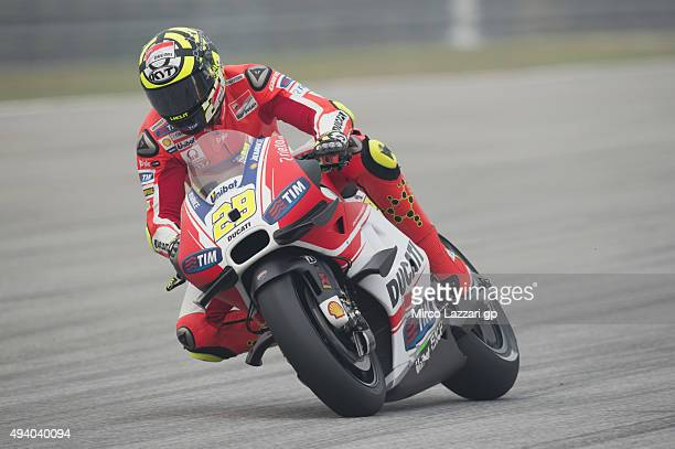 Andrea Iannone of Italy and Ducati Team down a straight during the qualifying practice during the MotoGP Of Malaysia at Sepang Circuit on October 24...