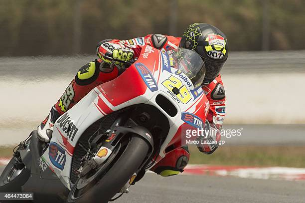 Andrea Iannone of Italy and Ducati Team heads down a straight during the Michelin test tyres during MotoGP Tests in Sepang Day Four at Sepang Circuit...