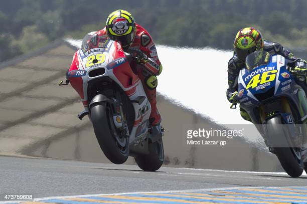 Andrea Iannone of Italy and Ducati Team leads Valentino Rossi of Italy and Movistar Yamaha MotoGP during the MotoGP race during the MotoGp of France...