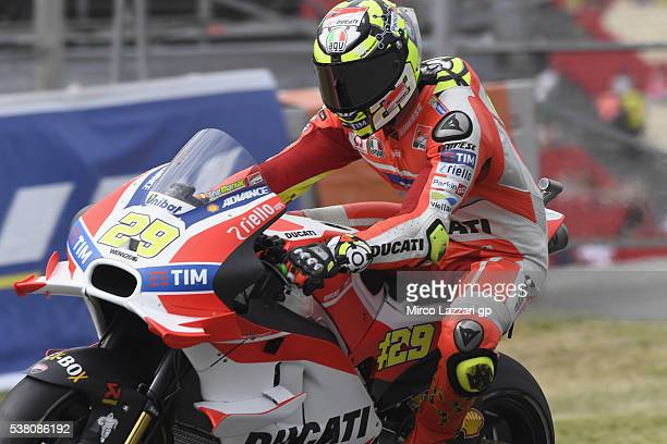 Andrea Iannone of Italy and Ducati Team lifts the front wheel during the qualifying practice during the MotoGp of Catalunya Qualifying at Circuit de...