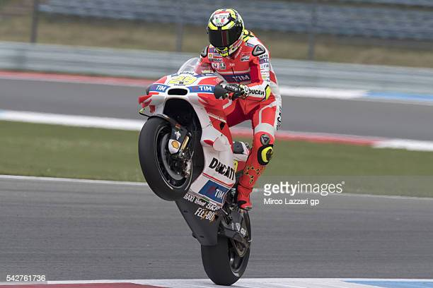 Andrea Iannone of Italy and Ducati Team lifts the front wheel during the MotoGP Netherlands Free Practice at TT Circuit on June 24 2016 in Assen...