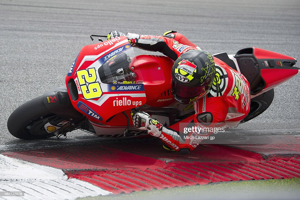 Andrea Iannone of Italy and Ducati Team rounds the bend during day one of the MotoGP tests at Sepang Circuit Sepang Circuit on February 4, 2015 in Kuala Lumpur, Malaysia.