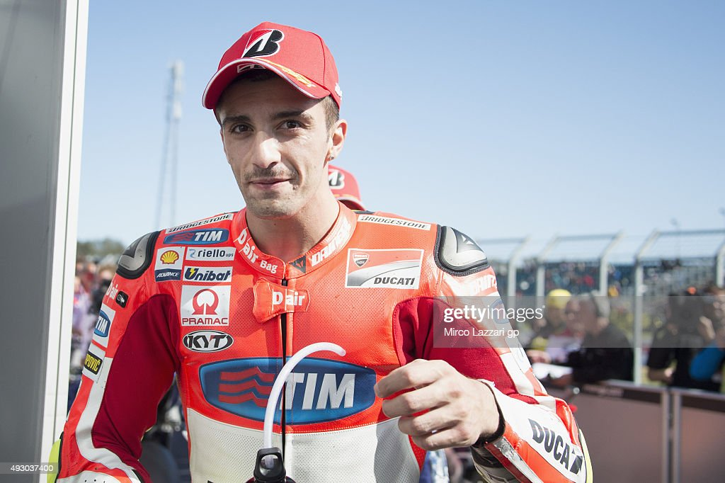 <a gi-track='captionPersonalityLinkClicked' href=/galleries/search?phrase=Andrea+Iannone&family=editorial&specificpeople=5314381 ng-click='$event.stopPropagation()'>Andrea Iannone</a> of Italy and Ducati Team smiles at the end of the qualifying practice during the MotoGP of Australia - Qualifying for the 2015 MotoGP of Australia at Phillip Island Grand Prix Circuit on October 17, 2015 in Phillip Island, Australia.