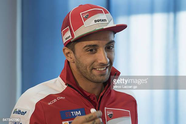 Andrea Iannone of Italy and Ducati Team smiles during the press conference during the MotoGp of Germany Preview at Sachsenring Circuit on July 14...