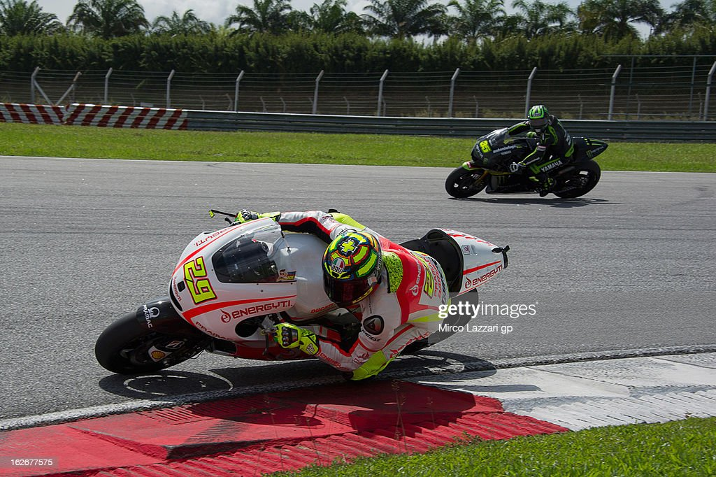 <a gi-track='captionPersonalityLinkClicked' href=/galleries/search?phrase=Andrea+Iannone&family=editorial&specificpeople=5314381 ng-click='$event.stopPropagation()'>Andrea Iannone</a> of Italy and Energy T.I. Pramac Racing Team rounds the bend during day one of MotoGP Tests at Sepang Circuit on February 26, 2013 in Kuala Lumpur, Malaysia.