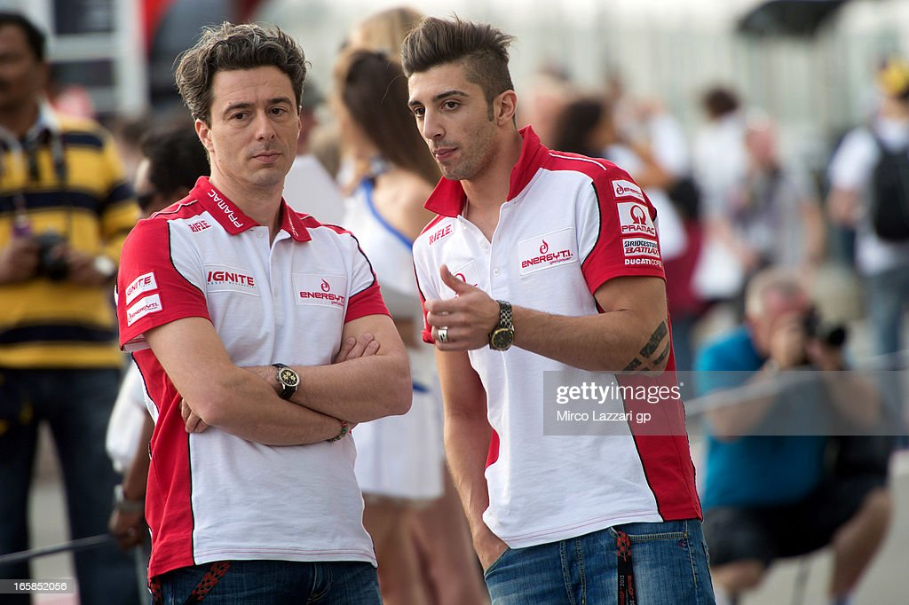 Andrea Iannone of Italy and Energy T.I. Pramac Racing Team speaks with a mechanic during the pit walk of the MotoGp of Qatar - Qualifying at Losail Circuit on April 6, 2013 in Doha, Qatar.