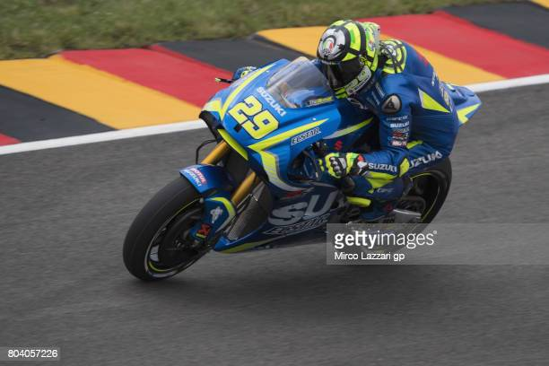 Andrea Iannone of Italy and Team Suzuki ECSTAR heads down a straight during the MotoGp of Germany Free Practice at Sachsenring Circuit on June 30...