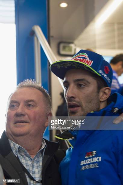 Andrea Iannone of Italy and Team Suzuki ECSTAR poses with fans during the MotoGP Tests In Valencia day 2 at Comunitat Valenciana Ricardo Tormo...