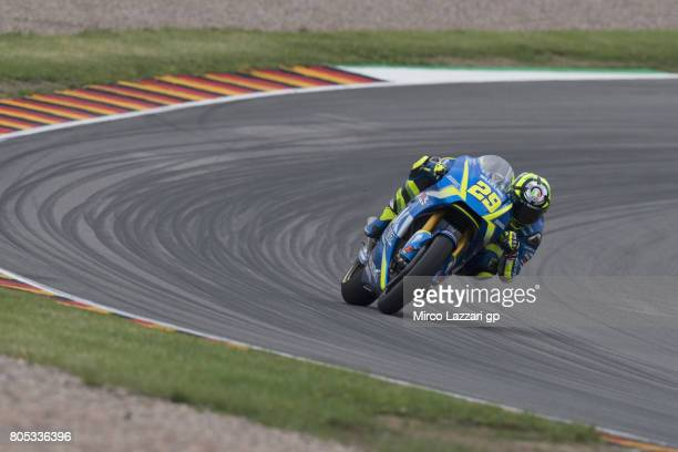 Andrea Iannone of Italy and Team Suzuki ECSTAR rounds the bend during the MotoGp of Germany Qualifying at Sachsenring Circuit on July 1 2017 in...