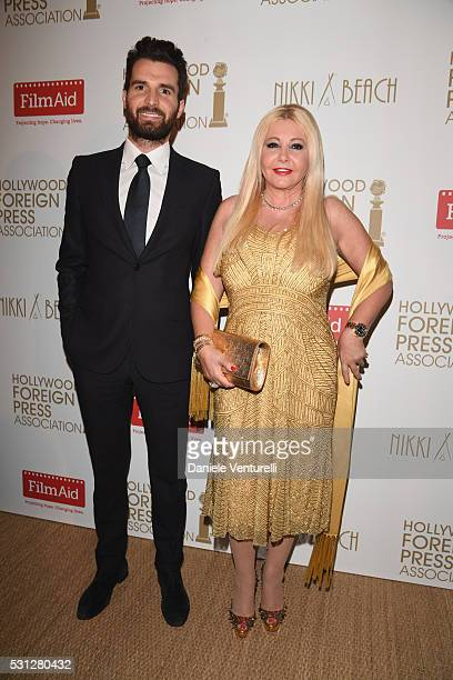 Andrea Iervolino and Monika Bacardi attend The Hollywood Foreign Press Association Honour Filmaid International party during The 69th Annual Cannes...