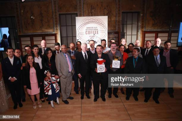 Andrea Illy Chairman of illycaff poses with guests at the Ernesto Illy International Coffee Award gala at the New York Public Library on Monday...