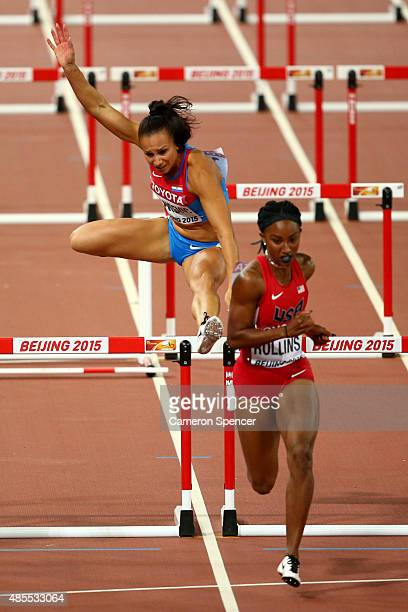 Andrea Ivancevic of Croatia falls in the Women's 100 metres hurdles next to Brianna Rollins of the United States in the Women's 100 metres hurdles...