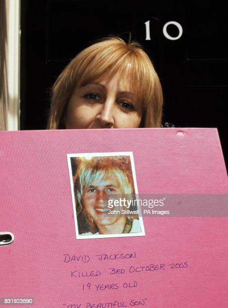 Andrea Jackson stands outside No10 Downing Street holding a folder containing a 10000 signature petition about road safety after her son David was...