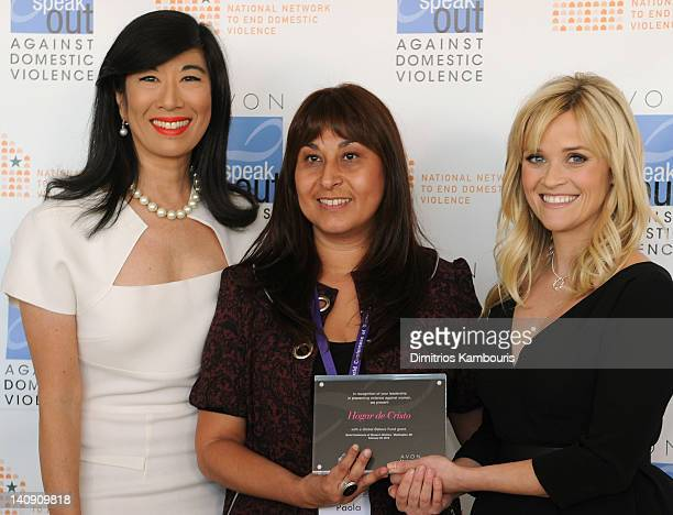 Andrea Jung and Reese Witherspoon present an Avon Global Believe Fund grant to Paola Perez a gender and communities supervisor with Chile's Hogar de...