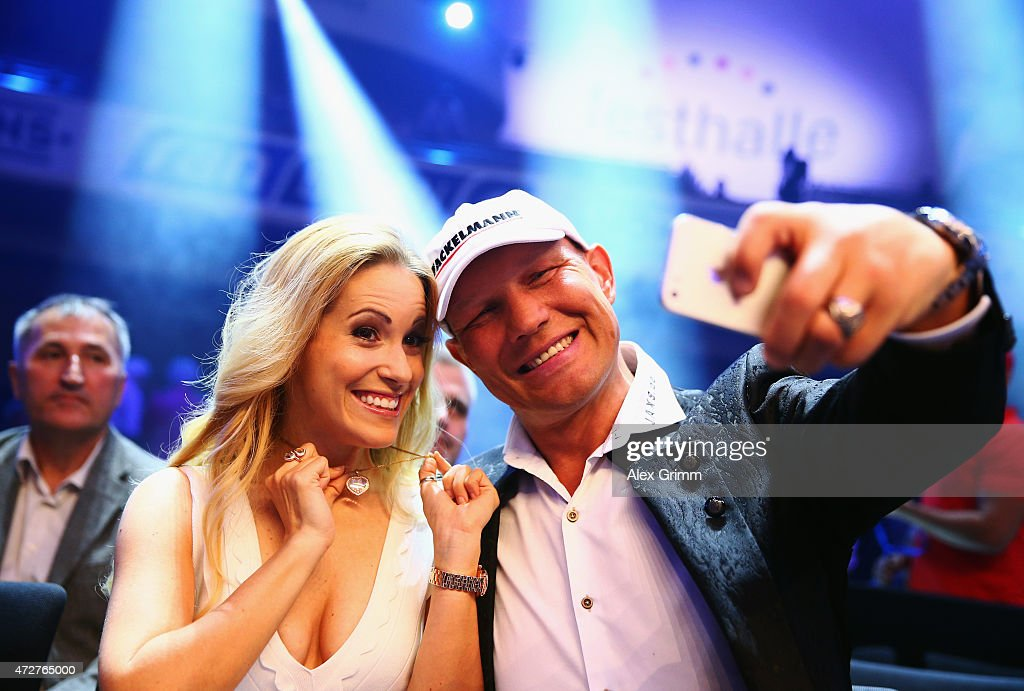 Andrea Kaiser and Axel Schulz pose prior to the WBA super middle weight World Championship fight between Felix Sturm of Germany and Fedor Chudinov of...