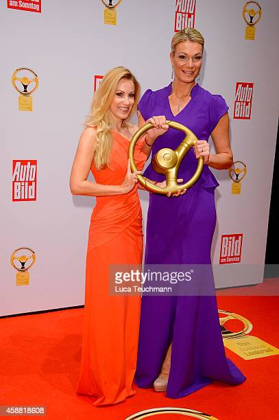 Andrea Kaiser and Maria HoeflRiesch attend 'Goldenes Lenkrad' Award 2014 at Axel Springer Haus on November 11 2014 in Berlin Germany