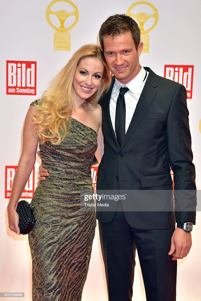 Andrea Kaiser and Sebastien Ogier attend the 'Goldenes Lenkrad' Award at Axel Springer Haus on November 8, 2016 in Berlin, Germany.