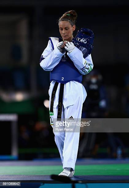 Andrea Kilday of New Zealand celebrates after being defeated by Iris Sing of Brazil during the Taekwondo Women's 49kg Round One contest at Cairoca...